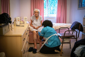 Elderly woman receiving care during the 2020 coronavirus pandemic